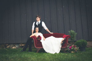 Bride and Groom on Red Velvet Couch
