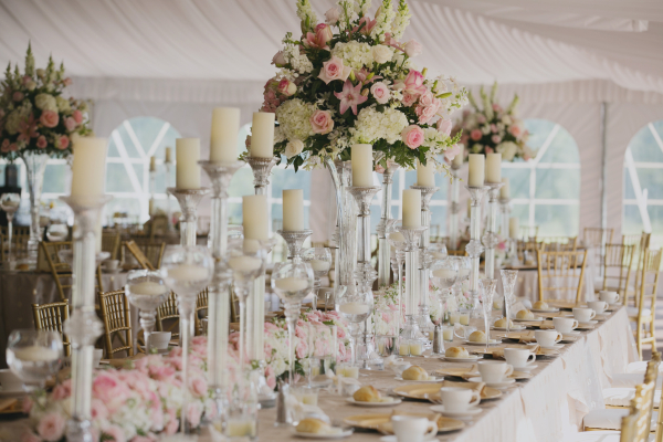 Cream and Pink Flowers and Candles on Reception Tables