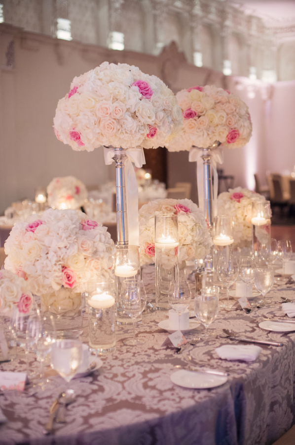 rose topiaries and floating candles reception decor