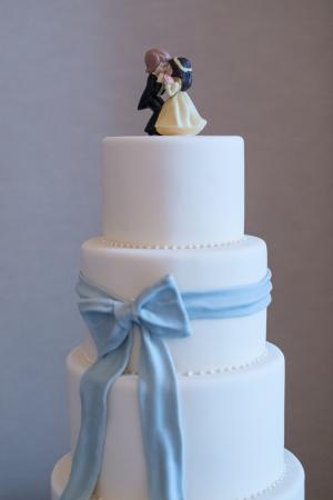 White Wedding Cake With Blue Fondant Bow