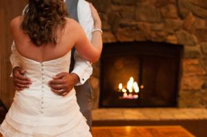 Bride and Groom Dancing Beside Fire