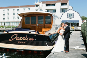 Bride and Groom Kissing Beside Boat