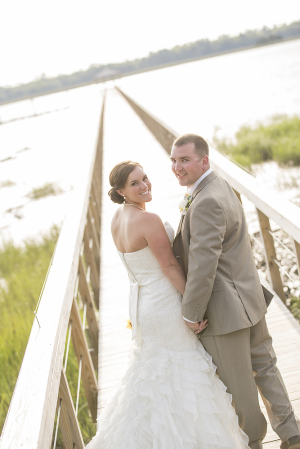 Bride and Groom on Bridge Over Marsh