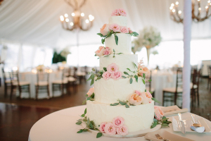 Buttercream Wedding Cake With Pink Roses and Greenery