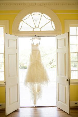 Detailed Bridal Gown Hanging in Doorway