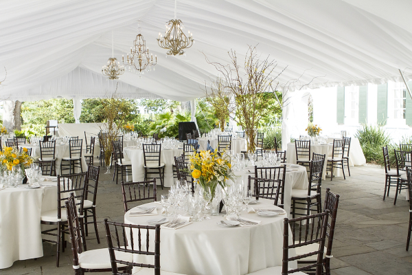 Gold Chandeliers Hanging in Reception Tent