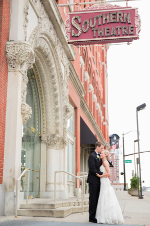 Bride and Groom Beneath Vintage Theater Sign