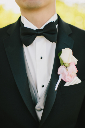 Groom with Double Rose Boutonniere