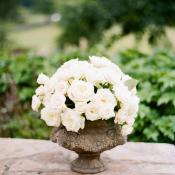 White Rose Centerpiece in Stone Vase