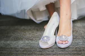 White Shoes with Silver Brooch