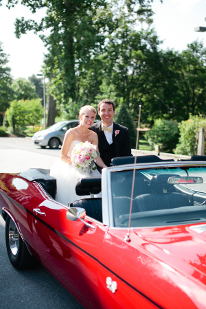 Bride and Groom in Red Convertible
