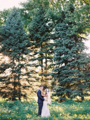 Bride and Groom in Wildflower Yard