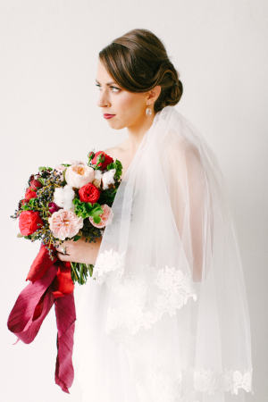 Elegant Bride with Red Bouquet