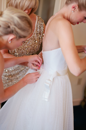 Mother Buttoning Bridal Gown