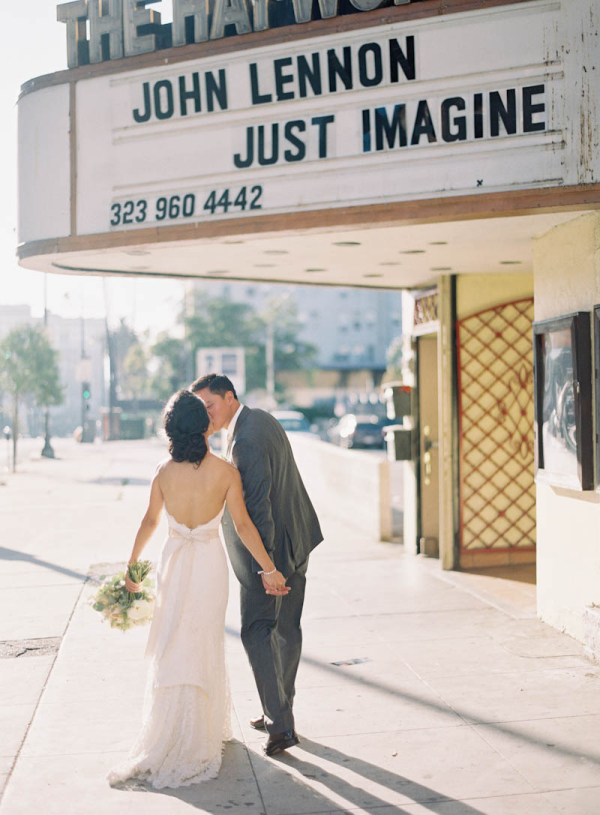 Bride and Groom Under Theatre Sign