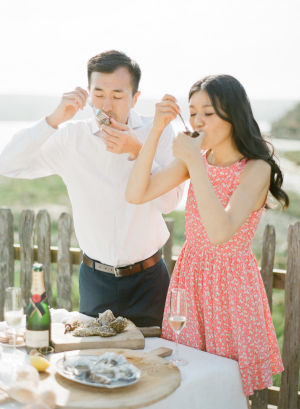 Couple Eating Oysters on Beach