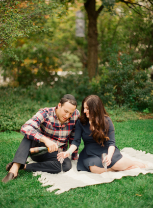 Couple on Picnic Blanket in Park