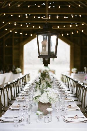 White Centerpieces in Barn Wedding