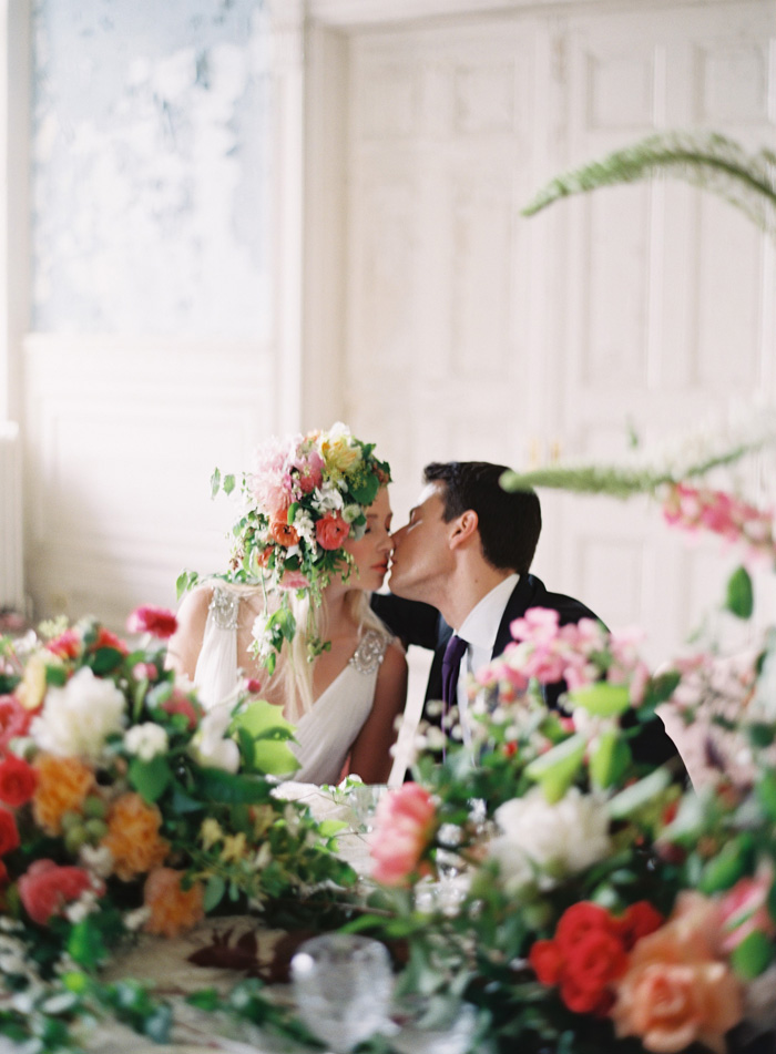 Couple Kissing at Floral Filled Table
