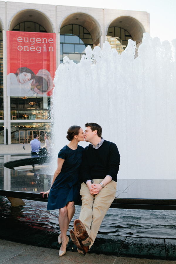 Couple Kissing in Front of Fountain