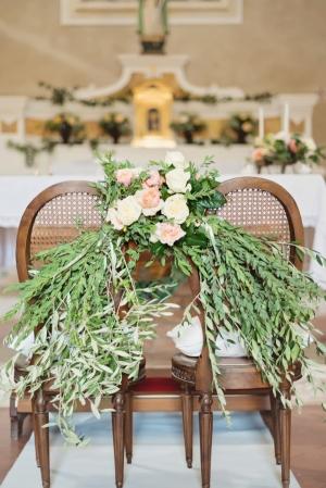 Floral Garland on Church Chairs Italian Wedding