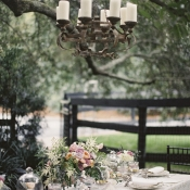 Iron and Candle Chandelier in Tree