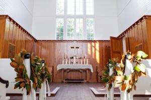 Magnolia Wreaths on Chapel Pews