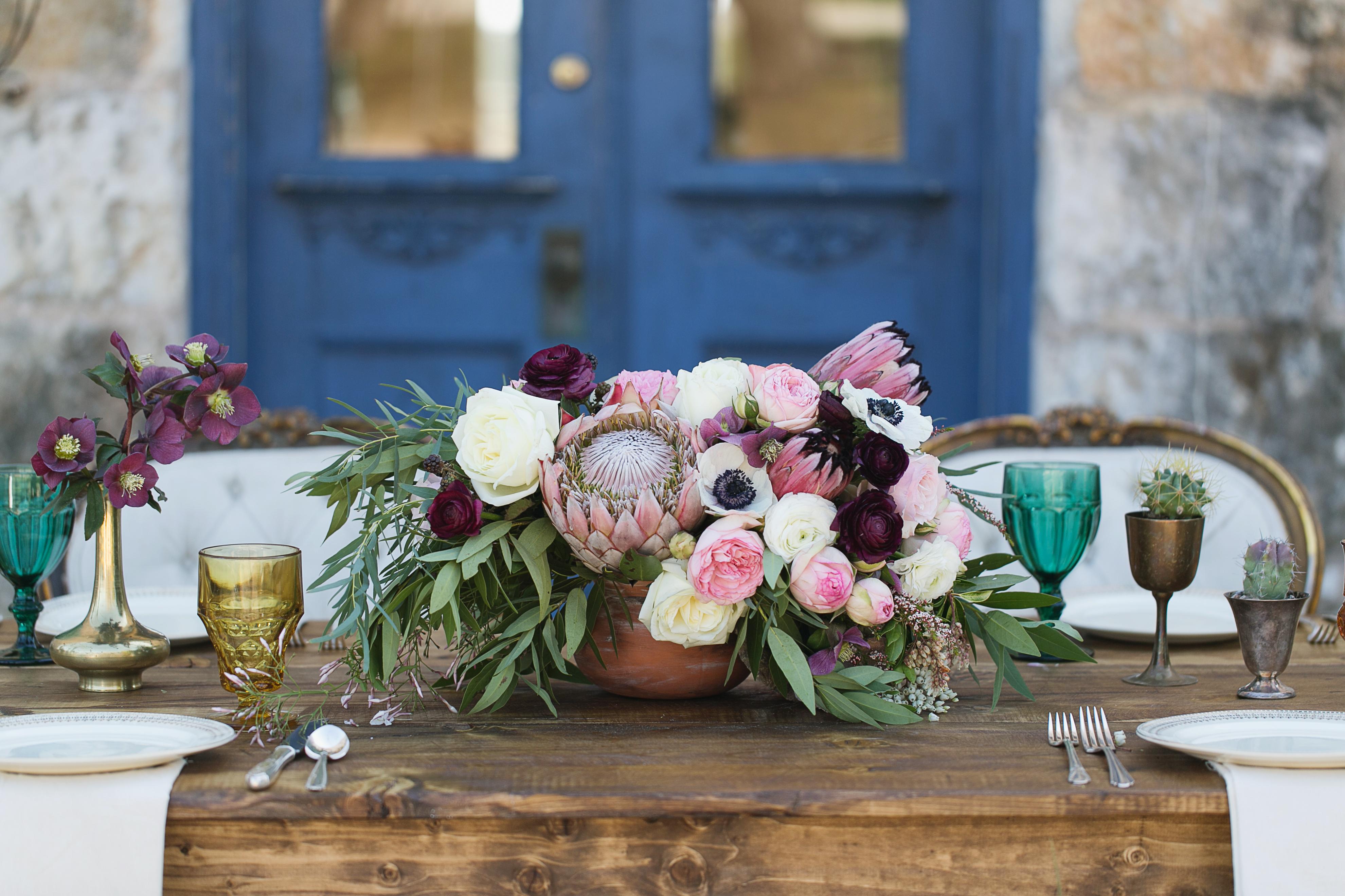 Protea peony and poppy centerpiece elizabeth anne