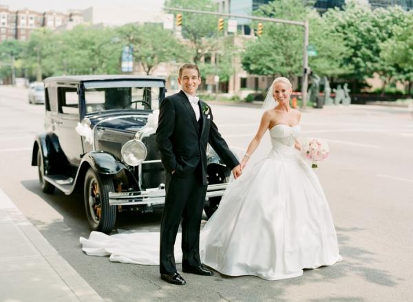 Bride and Groom Beside Vintage Car
