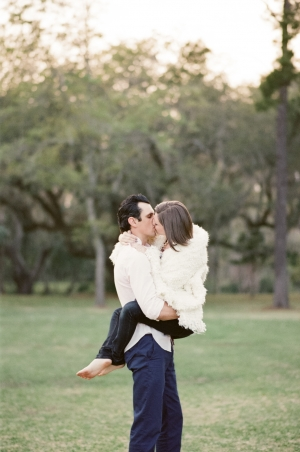 Groom Holding Bride Engagement Poses