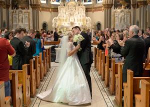Elegant Church Wedding Bride and Groom Kissing