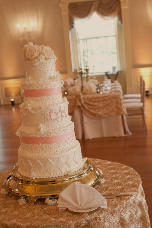 Intricate Pink and White Wedding Cake