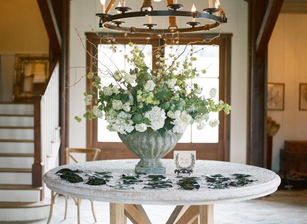 Escort Card Table with Flowers in Urn