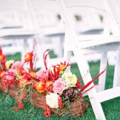 Orange and Coral Flowers Along Wedding Aisle