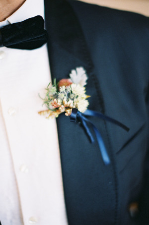 Boutonniere Tied with Blue Ribbon
