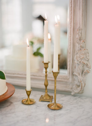 Taper Candles in Gold Candlesticks