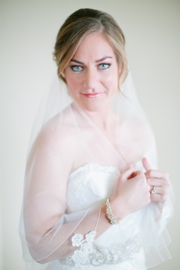 Bride in Lace Trimmed Wedding Veil