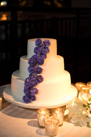 Wedding Cake with Purple Icing Flowers