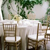 White Reception Table with Gold Chairs