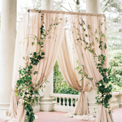 Draped Blush Ceremony Arbor with Ivy