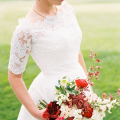 Bride with Bouquet in Shades of Red