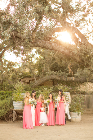 Bridesmaids in Strapless Coral Dresses