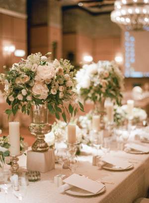 Centerpieces of Ivory Roses in Silver