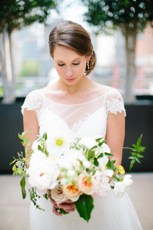 Bride with Ivory and Peach Bouquet