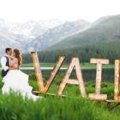 Bride and Groom by Vail Sign
