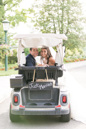 Bride and Groom in Golf Cart