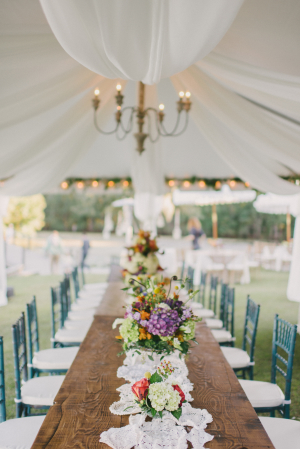 Tent Wedding Reception with Purple Flowers