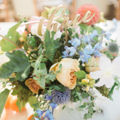 Centerpiece with Blue and Peach Flowers
