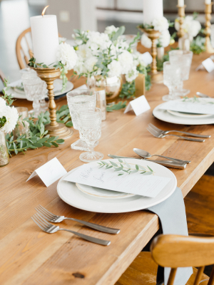 Green and Gold Centerpiece on Wood Table