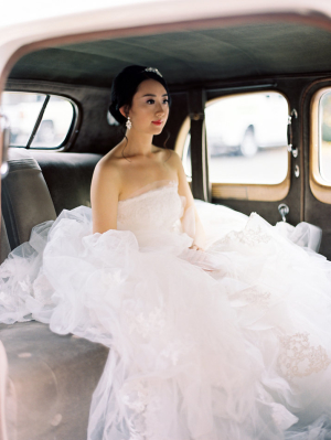 Bride in Vintage Wedding Car